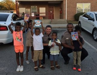 Bibb Sheriff's Deputies call for Back-up for more Books!