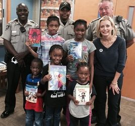 Bibb Sheriff's Office and Book 'Em Deliver Books to Children Affected by Hurricane Matthew