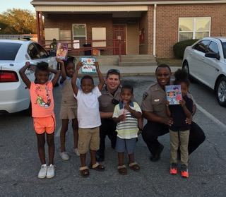 Sheriff Giving Books to Macon Children
